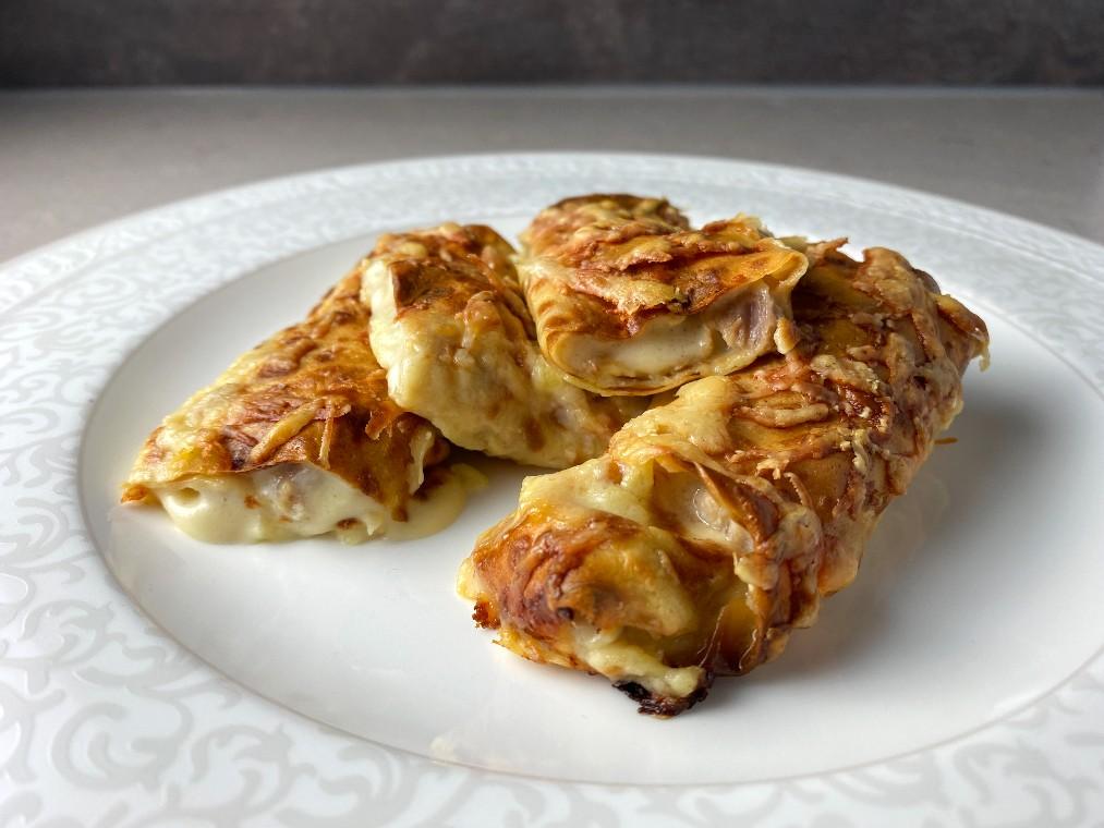 Crepes med ost och skinkstuvning